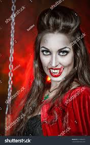 beautiful halloween vampire woman long tongue stock photo