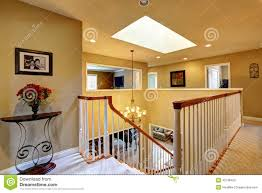 luxury house interior upstairs hallway with staircase stock photo