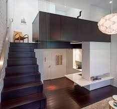 apartment attractive seats in front of bookshelves at small apartment contemporary dark wood small apartment ideas with stair braid set also brick patterned wall