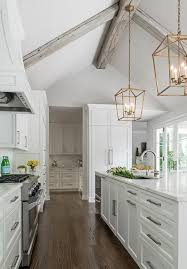 white kitchen cabinets with wood beams white kitchen with vaulted ceiling accented with gray wood