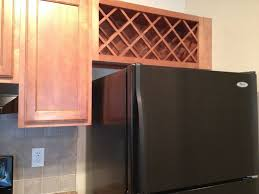 wine rack cabinet over refrigerator turn a cupboard into a wine rack google search remodel