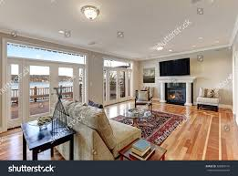 floor to ceiling glass doors luxury spacious family room interior wall stock photo 566869141