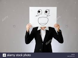 big laughing face illustration on blank white board holding by