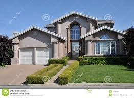 two car garage house with decorative schrubs stock photo image