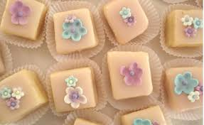 square cupcakes of small square cupcakes with colorful floral toppers png
