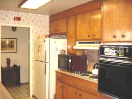 are wood kitchen cabinets outdated how to update a dated home without remodeling design
