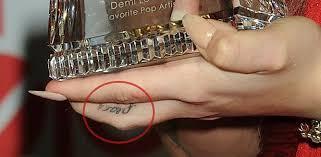 finger tattoo peace demi lovato s 19 tattoos their meanings body art guru