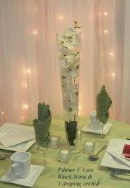 Vase And Candle Centerpieces by Wedding Centerpiece Fuchsia Dendrobium Orchids In A Pilsner Vase