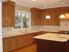 white kitchen cabinets with wood crown molding white crown molding oak cabinets