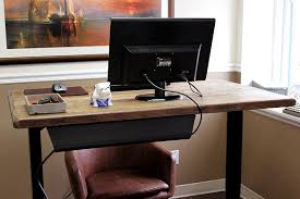 in review the uplift stand up desk w reclaimed wood top