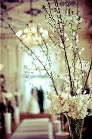 white flowering branches u0026 a collar of creamy white u0026 blush roses