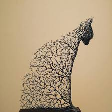 surreal animal sculptures made of metallic branches pays homage to