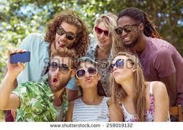 selfie five happy comic friends beaming stock photo 567907741