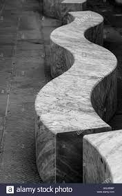 a marble bench in carrara in front of the art of carrara