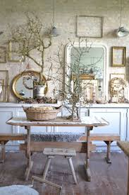 mirrors and empty frames used in a wall arrangement pretty home