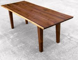 walnut live edge dining table with tapered legs nakashima