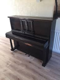 piano free to a good home moving home so has to go in