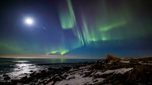reykjavik iceland northern lights moonlight ocean bay northern lights aurora bright night reykjavik