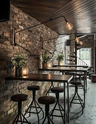 black chairs and metal tables for cozy coffee shop interior design