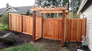 hand built cedar trellis arbor with gate and estate style cedar