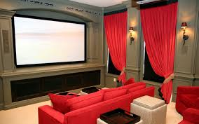 home theater design and installation homesfeed private home theater with bright red sofas red window curtains big screen a pair of lighting