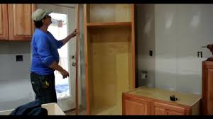 how to put filler on kitchen cabinets filler