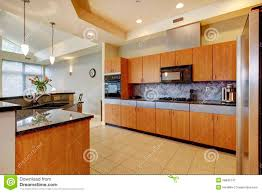 modern wood kitchen large modern wood kitchen with living room and high ceiling stock