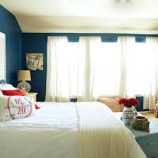 Beach Bedroom Ideas by Lovely Light Blue Walls Of Beach Bedroom With Wood Bed Frame Plus