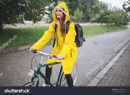 bike raincoat young woman yellow raincoat ride bicycle stock photo 648571582