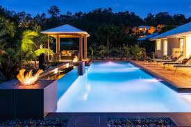 Backyard Paradise Ideas Outdoors Mesmerizing Pool And Deck With Pits And A Relaxing
