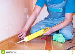 Laminate Floor Caulk Repairman Installing Skirting Board Oak Wooden Floor With Caulking