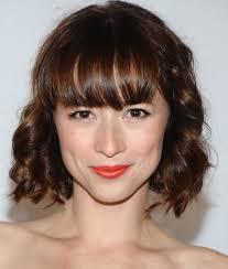 short choppy side bangs women medium haircut