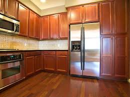 alder kitchen cabinets on dark floor innovative home design