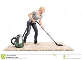 woman vacuuming a carpet with vacuum cleaner stock photo image