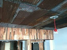 using corrugated metal for ceiling the coat shop building
