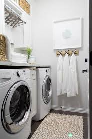 gray laundry room walls with gray slate floors transitional
