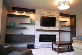 built in tv on the wall above fireplace plus mosaic wall tile for small living room