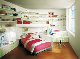 small kids bedroom with bunk bed and red bed color corner desk and chair and green wall storage image