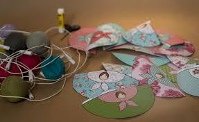 guirlande pour chambre bébé guirlande lumineuse de poupées en papier pour chambre bébé