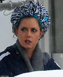 husband forced to sleep in hair rollers amy adams sports zebra print shower cap over curlers on set of the