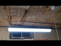 led vs fluorescent shop lights lowe s utilitech pro 48 led shop light installation highlights