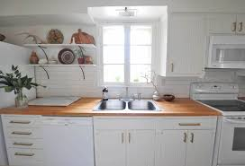 kitchen remodel couple uses diy projects to update kitchen