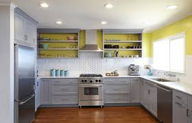 yellow cabinets and drawers gray painted wall with ceramic tile