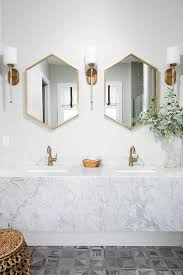 two west elm metal framed hexagon mirrors antique brass are
