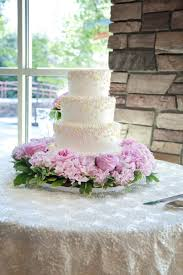 classic wedding cake with pink flower garland elizabeth anne