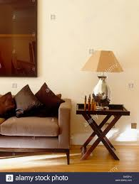 Table Lamps For Living Room Next Silver Lamp With Beige Shade On Dark Wood Side Table Next To Beige