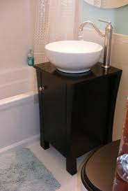 sink and vanity cabinet only 18 inches wide it s a tiny bathroom