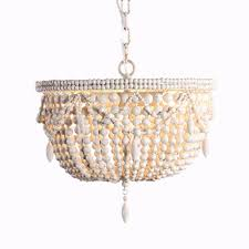 au courant interiors coastal beaded chandeliers casual luxury