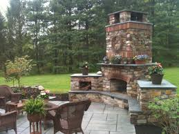 Simple Brick Patio With Circle Paver Kit Patio Designs And Ideas by Decor Best Outdoor Patio Ideas With Winsome Unilock Fireplace