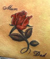beautiful rose with mum and dad names tattoo